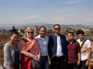 With ceramic artists Ramesh Pradhan and Gopal Kalapremi (ceramic artist and professor of art) Shrestha and ceramic students from Department of Arts, Kathmandu University in Bhaktapur, in April 2014. Many of the buildings in the background are potter's houses and courtyards and are now destroyed.